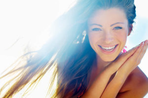 Closeup of a beautiful smiling young woman  http://azarubaika.com/iStockphoto/2012_08_19_Victoria_Beach.jpg